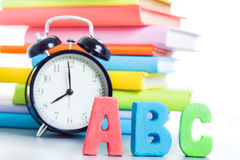Alarm clock and stack of books Royalty Free Stock Image