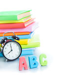 Alarm clock and stack of books Stock Images