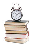 Alarm clock with a stack of books Royalty Free Stock Image