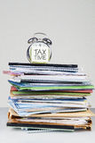 Alarm clock with stack of documents Stock Photos