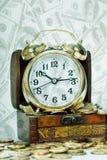 Alarm clock  stand on a chest Stock Photos