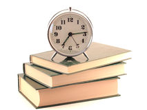 Alarm clock standing on books Royalty Free Stock Images
