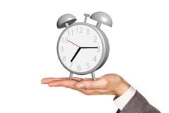 Alarm clock stands on the human palm Royalty Free Stock Photography