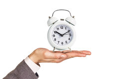 Alarm clock stands on the human palm Royalty Free Stock Image