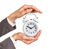Alarm clock stands on the human palm Stock Photo
