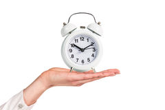 Alarm clock stands on the human palm Royalty Free Stock Images