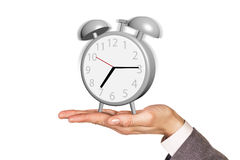 Alarm clock stands on the human palm Stock Photography