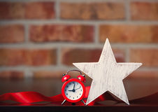 Alarm clock and star Royalty Free Stock Photos