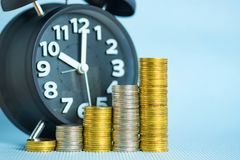 Alarm clock and step of coins stacks, time for savings money con Stock Image