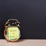 Alarm clock and sticker with text back to school Royalty Free Stock Photo