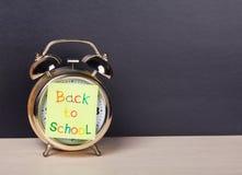 Alarm clock and sticker  to school Stock Photos