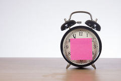 Alarm clock with sticky note stock photo