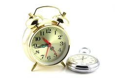 Alarm clock and stop-watch Stock Photos