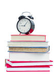 Alarm clock on stuck of books Royalty Free Stock Image
