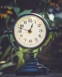 Alarm clock in sunlit spring garden stock photos