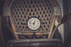Alarm clock in sunlit spring garden royalty free stock photos