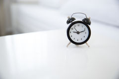 Alarm clock on the table Royalty Free Stock Image