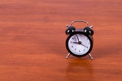 Alarm Clock on Table Stock Images
