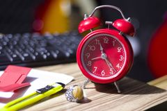 ALARM CLOCK ON THE TABLE stock photography