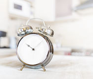 Alarm clock on a table in the kitchen Stock Images