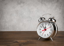 Alarm clock on table over vintage background Stock Photography
