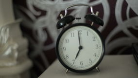 Alarm clock on the table. stock footage