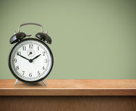 Alarm clock on table or shelf background Stock Photos