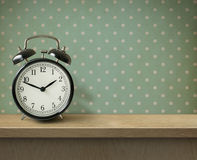 Alarm clock on table or shelf background Stock Images