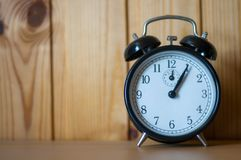 Alarm clock on table. Time stock photography