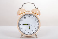 Alarm clock on a table Royalty Free Stock Photos