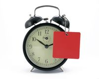 Alarm clock with a tag Royalty Free Stock Photos