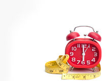 Alarm clock , tape measure, Royalty Free Stock Image