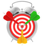 Alarm-clock and target for darts with dart in the Royalty Free Stock Photo