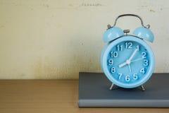 Alarm clock on text books. Royalty Free Stock Photos