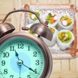 Alarm clock  and Tim Sum Royalty Free Stock Photos