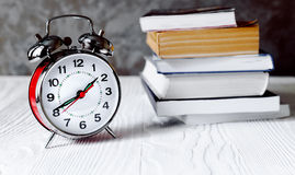 Free Alarm Clock Time To Read Books Close Up Stock Images - 74799114