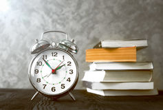 Alarm clock time to read books Royalty Free Stock Photo