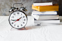 Alarm clock time to read books Royalty Free Stock Image