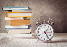 Alarm clock time to study with books Stock Photo