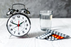 Alarm clock time to take medicine Royalty Free Stock Image