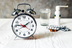 Alarm clock time to take medicine Royalty Free Stock Photos
