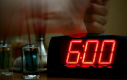 Alarm Clock. Time to wake up. Pounding the buzzer Stock Image