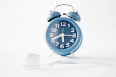 Alarm Clock And Toothbrush Royalty Free Stock Photo