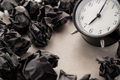 Alarm clock with trash paper Stock Images