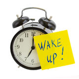 Alarm clock with wake up! note. Isolated on white background Stock Image