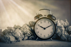 Alarm clock in a wastepaper Royalty Free Stock Photo
