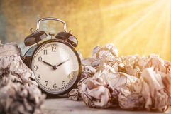 Alarm clock in a wastepaper concept Royalty Free Stock Photo