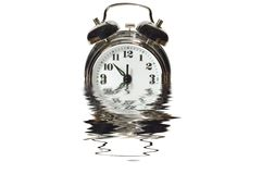 Alarm clock in water Stock Photography