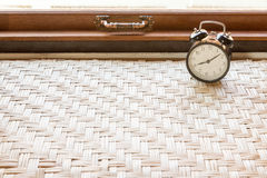 Alarm clock on weave table Stock Photography