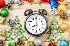 Alarm clock whit christmas decaotrions. Stock Photography
